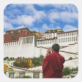 China, Tibet, Lhasa, Tibetan monk with Potala Sticker