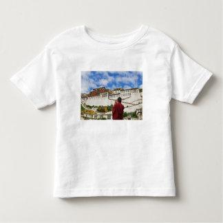 China, Tibet, Lhasa, Tibetan monk with Potala Toddler T-shirt
