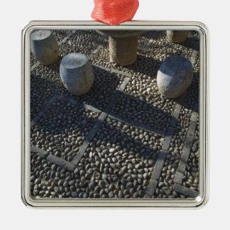 CHINA, Yunnan Province, Lijiang. Old Town, Stone Metal Ornament