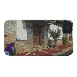 CHINA, Yunnan Province, Tianshengying. Drying iPhone 4 Cover