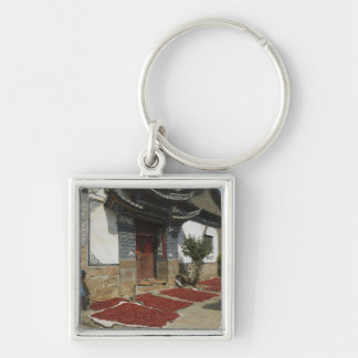 CHINA, Yunnan Province, Tianshengying. Drying Keychain