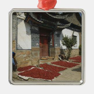 CHINA, Yunnan Province, Tianshengying. Drying Metal Ornament