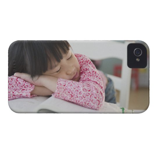 Chinese girl napping on textbooks iPhone 4 case