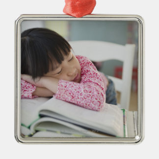 Chinese girl napping on textbooks metal ornament