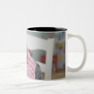 Chinese girl napping on textbooks Two-Tone coffee mug