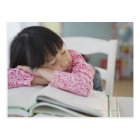 Chinese girl napping on textbooks postcard
