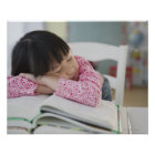 Chinese girl napping on textbooks poster