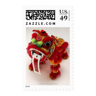 Chinese toy dragon on white background postage stamp