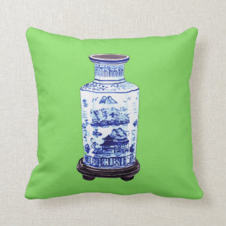 CHINESE VASE ON GREEN PILLOWS