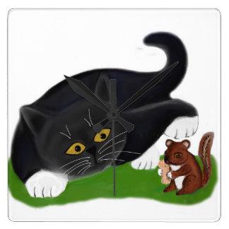 Chipmunk Holds a Peanut as Tuxedo Kitten Pats its Square Wall Clocks