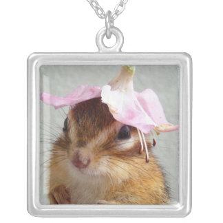 Chipmunk wears flower hat square pendant necklace