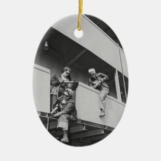 Chipping Slag Off a Ship Ceramic Ornament