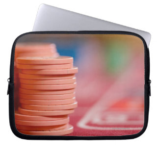 Chips on betting table 2 laptop sleeves