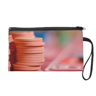 Chips on betting table 2 wristlet purse