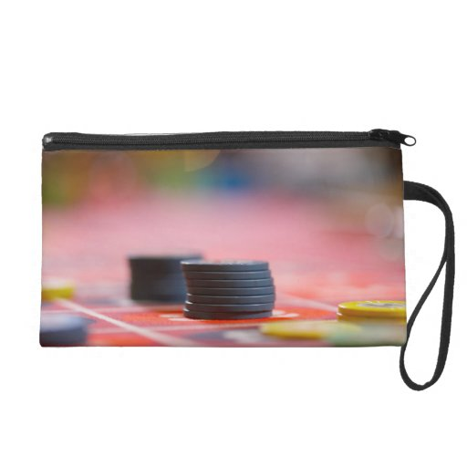 Chips on betting table 3 wristlet clutch