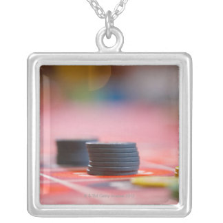 Chips on betting table 3 silver plated necklace