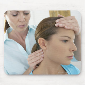 Chiropractic examination of the neck. The Mouse Pad