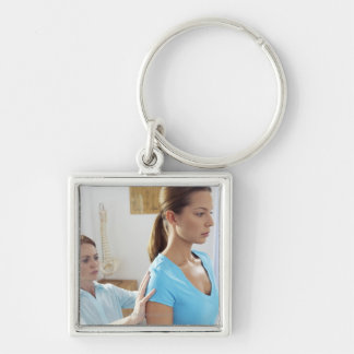 Chiropractic examination of the thoracic spine. keychain