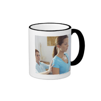Chiropractic examination of the thoracic spine. ringer coffee mug