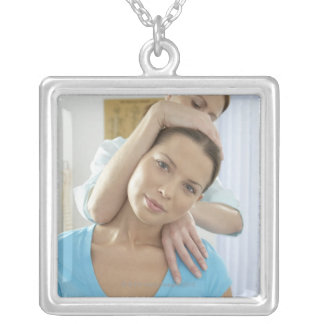 Chiropractic treatment. Chiropractor treating Square Pendant Necklace