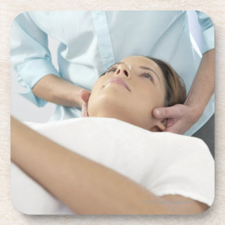 Chiropractic treatment of the neck using the beverage coaster