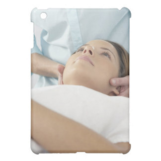 Chiropractic treatment of the neck using the iPad mini covers