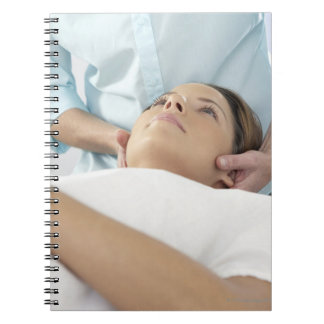 Chiropractic treatment of the neck using the notebook