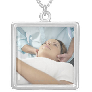 Chiropractic treatment of the neck using the square pendant necklace