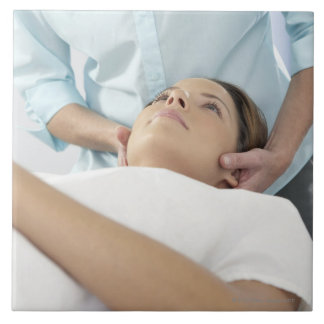 Chiropractic treatment of the neck using the tile