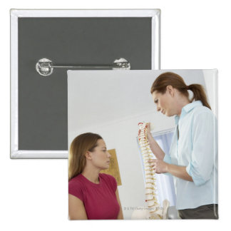 Chiropractor and patient. The chiropractor is Button