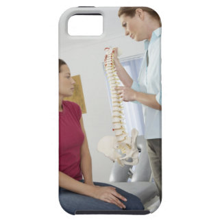 Chiropractor and patient. The chiropractor is iPhone 5 Cover