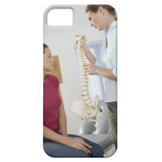 Chiropractor and patient. The chiropractor is iPhone 5 Covers