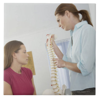 Chiropractor and patient. The chiropractor is Ceramic Tile