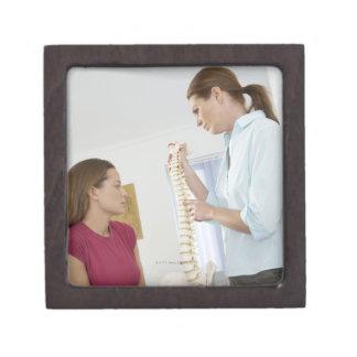 Chiropractor and patient. The chiropractor is Keepsake Box