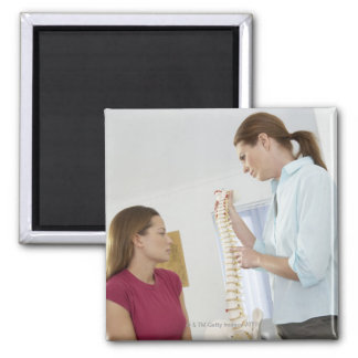 Chiropractor and patient. The chiropractor is Magnet