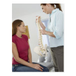 Chiropractor and patient. The chiropractor is Postcards