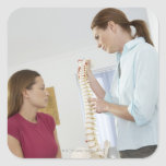 Chiropractor and patient. The chiropractor is Sticker