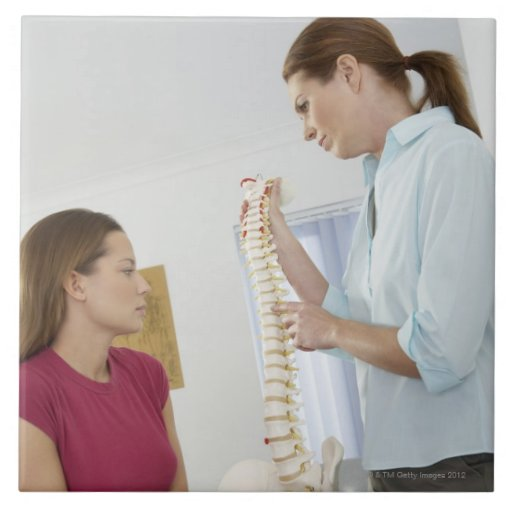 Chiropractor and patient. The chiropractor is Tiles