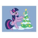 Chispa crepuscular que adorna el árbol de navidad postal