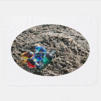 chispa de los bulbos del navidad en la arena mantitas para bebé