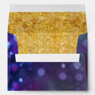 Chispa púrpura azul del brillo del oro de Bokeh Sobre