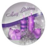 Chispa púrpura de las velas del navidad platos