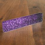 Chispas púrpuras hermosas del brillo