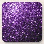 Chispas púrpuras hermosas del brillo posavaso