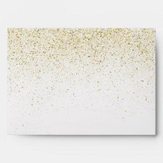 Chispas relucientes del oro sobres