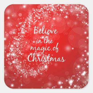 Chispas rojas con cita mágica del navidad pegatina cuadrada