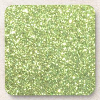 Chispas verdes claras del brillo posavasos de bebida
