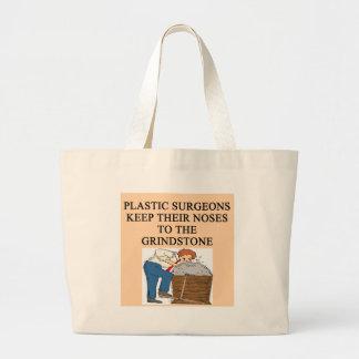 chiste de la cirugía del cirujano plástico bolsa
