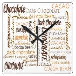 Chocolate, almendras y diseño oscuro del texto del relojes