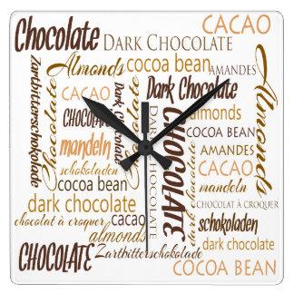 Chocolate, almendras y diseño oscuro del texto del reloj cuadrado